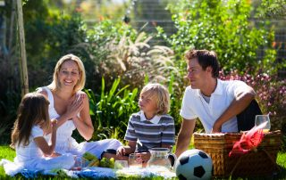Happy family having a picnic in a park